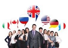 Mensen die met buitenlandse toespraakbellen spreken Stock Afbeelding