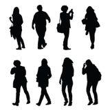 Mensen die silhouetreeks lopen  Royalty-vrije Stock Afbeeldingen