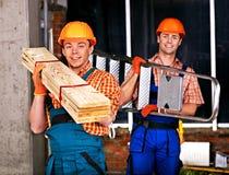 Mensen in eenvormige bouwer. stock afbeeldingen