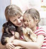 Mensen en honden Stock Afbeeldingen