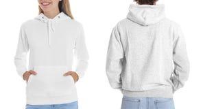 Mensen in lege hoodiesweaters op witte achtergrond, close-up stock foto