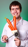 Mensen met bijl en wortel stock foto