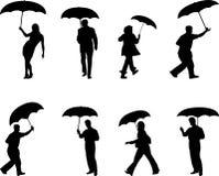 Mensen met paraplu's Royalty-vrije Stock Afbeeldingen