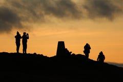 Mensen op heuvel Stock Afbeelding
