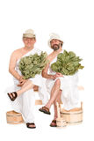 Mensen op middelbare leeftijd in Russische sauna het baden kostuums stock foto's
