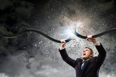 Mensen tearing kabel Stock Fotografie