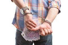 Mensen verbergend geld achter achter en het maken duim op gebaar stock foto