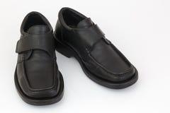 Mensen zwarte die schoenen op witte achtergrond worden geïsoleerd Stock Foto's