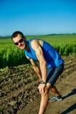 Mensenagent die vóór jogging opwarmen Royalty-vrije Stock Afbeelding