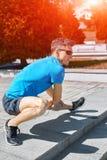 Mensenagent die vóór jogging opwarmen Stock Foto