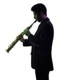 Mensensaxofonist het spelen het silhouet van de saxofoonspeler Royalty-vrije Stock Afbeelding