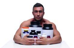Mensenzitting bij de lijst met sportenvoeding Stock Foto