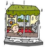 Mensenzitting door een venster op een regenachtige dag Royalty-vrije Stock Afbeelding