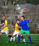 Mensklumpen Fußball-Auge auf der Kugel Lizenzfreies Stockbild