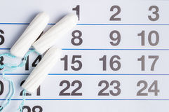 Menstrual calendar with tampons and pads. Menstruation cycle. Hygiene and protection stock image