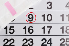 Menstrual calendar with tampons and pads. Menstruation time. Hygiene and protection stock image