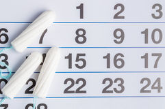 Menstrual calendar with tampons and pads. Menstruation time. Hygiene and protection stock photos