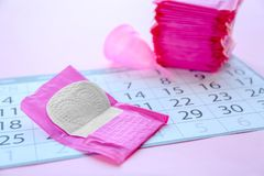 Menstrual pad and calendar on table. Gynecological care royalty free stock image