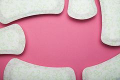 Menstrual pad isolated on pink background, copy space stock photography