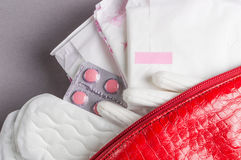 Menstrual tampons and pads in cosmetic bag. Menstruation time. Hygiene and protection Royalty Free Stock Images