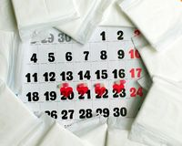 Menstruation cycle concept. Menstruation calendar with sanitary pads, contraceptive pills. Menstruation cycle concept. Menstruation cycle concept. Menstruation royalty free stock photography