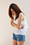 Menstruation pain or stomach ache Stock Image