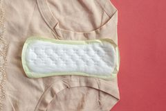 Menstruation sanitary pads for woman hygiene protection on plaid at home. Protection for woman critical days, gyne. Cological menstruation cycle royalty free stock photos