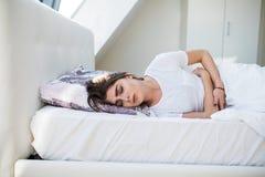 Menstruationsschmerz stockbild