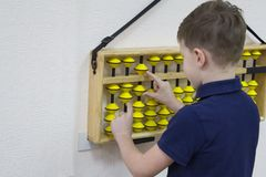 Mental arithmetic. School. Boy counts with abacus in `soroban` class. Japanese abacus. Concept of back to school.copy space Royalty Free Stock Photography