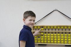 Mental arithmetic. School. Boy counts with abacus in `soroban` class. Japanese abacus. Concept of back to school.copy space Royalty Free Stock Photo