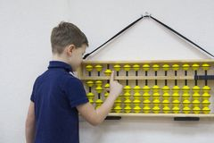 Mental arithmetic. School. Boy counts with abacus in `soroban` class. Japanese abacus. Concept of back to school.copy space Stock Photo