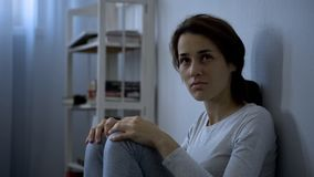 Mental disease patient sitting on floor, hospital therapy, schizophrenia stock image