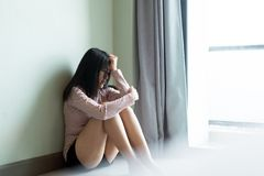 Mental disorder health care concept,Asian female feeling depression of lonely have a headache while sitting in room royalty free stock images