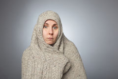 Mental disorder and schizophrenia in a young girl. Girl hid in a large sweater and surprised and confused looking at the camera Stock Photos