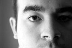 Mental Health. A young man with a serious look on his face in black and white Royalty Free Stock Photo