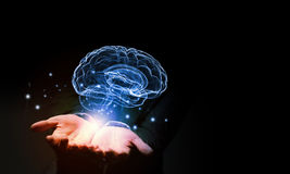 Mental health. Close up of businessman holding digital image of brain in palm Stock Photography