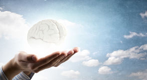 Mental health. Close up of human hand holding brain Royalty Free Stock Images