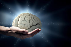 Mental health. Close up of human hand holding brain Stock Photo