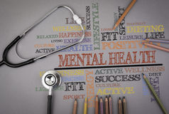 Mental Health. Colored pencils and a stetoscope on the table Royalty Free Stock Photography