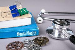 Mental health concept. blue book on a gray office table. Communication and information stock photography