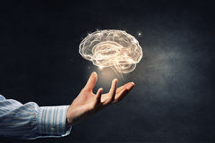 Mental health concept. Close up of human hand holding brain symbiol Royalty Free Stock Photo