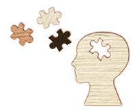 Mental health symbol. Human head silhouette with a puzzle Royalty Free Stock Photos