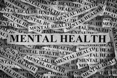 Mental health. Torn pieces of paper with the words . Concept Image. Black and White. Closeup Stock Photos