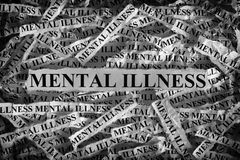 Mental illness. Torn pieces of paper with the words . Concept Image. Black and White. Closeup Royalty Free Stock Photography