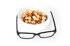 Mental pabulum concept. Nuts and glasses Stock Photo