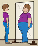 Mental Reflection. Normal sized woman sees herself as obese in mirror Royalty Free Stock Photo