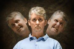 Mentalement - personnalité fendue mauvaise bipolaire Photos libres de droits