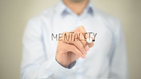 Mentality , Man writing on transparent screen stock photography