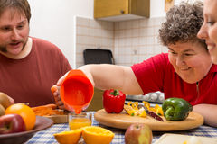 Mentally Disabled Woman And Two Caretakers Cooking Together Royalty Free Stock Photography