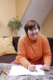 Mentally disabled woman painted hearts Stock Photography